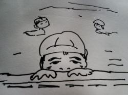 プールの縁から顔だす息子